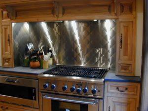 Rustic Kitchen with Quilt Pattern Stainless Steel Backsplash