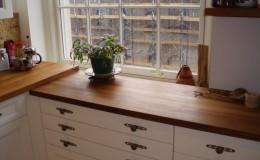 Teak Edge Grain Wood Countertop in a White Kitchen