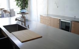 Stainless Steel Island Countertop in a Minimalist Kitchen