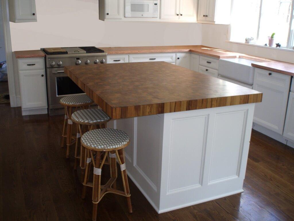 Warm Teak Butcher Block Wood Countertop In A Bright White Kitchen