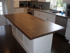 Crisp Modern Kitchen With Walnut Island Wood Countertop
