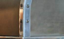 Closeup of a Custom Zinc Range Hood with Rivets