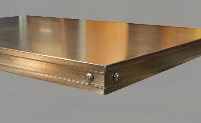 Artisan Cast Bronze Countertop with Rivets